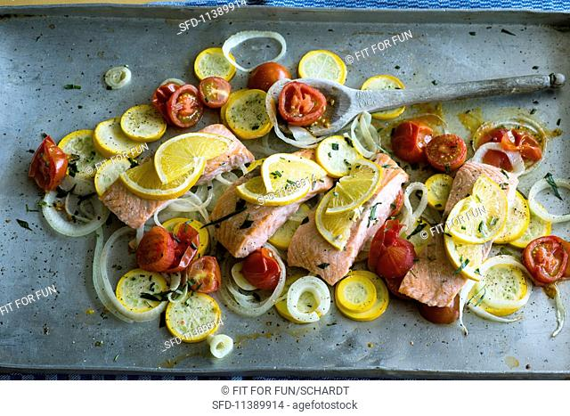 Roasted salmon with a courgette and onion medley