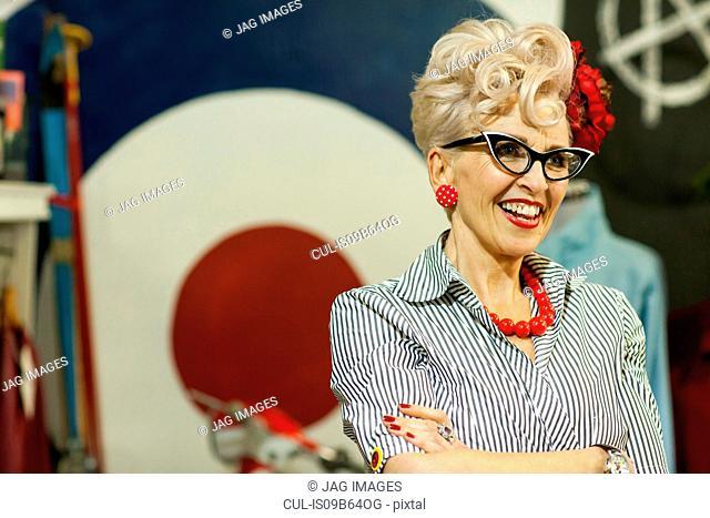 Portrait of quirky vintage woman in antique and vintage emporium