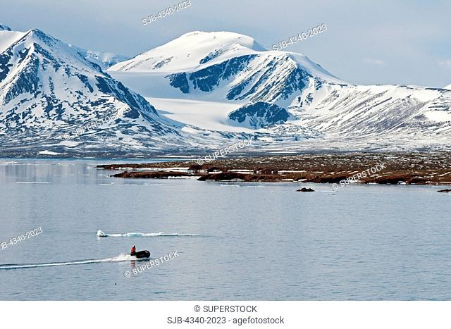 Zodiac heads out to Andoyane island to look for polar bears, Liefdefjorden, northwest Svalbard, Norway, in summertime