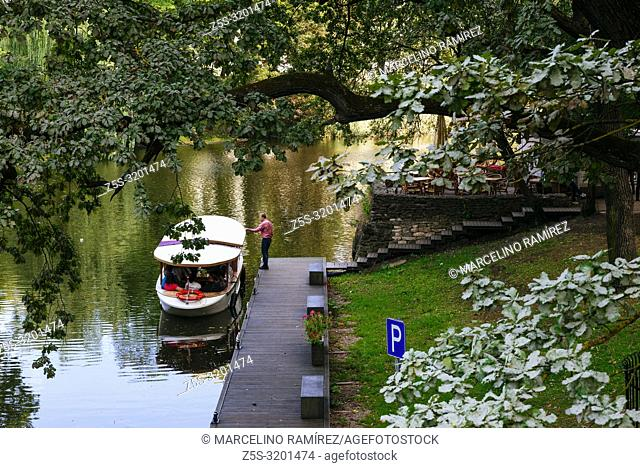 Riga canal, pleasure boats in Bastion Hill Park, Bastejkalns, in the City Canal area of central Riga. Riga, Latvia, Baltic states, Europe