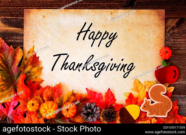 Old Vintage Paper With Text Happy Thanksgiving. Colorful Autumn Decoration Like Pumpkin and Leaves