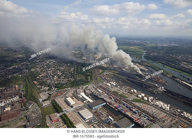 Aerial view, smoke, fire on a scrap island in the Duisport inland port, Duisburg, Ruhrgebiet region, North Rhine-Westphalia, Germany, Europe
