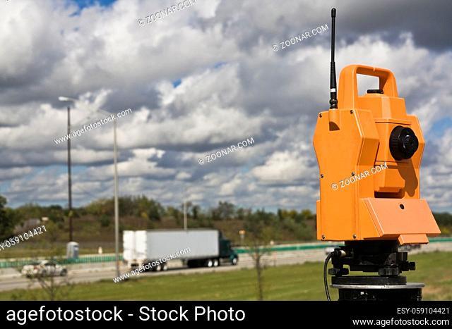 Survey on the highway - orange theodolite