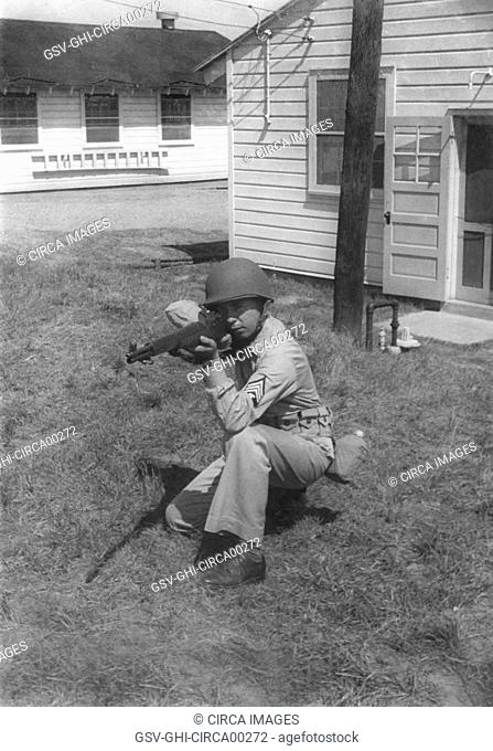 Soldier Displaying Proper Shooting Position During Training Session, WWII, 2nd Battalion, 389th Infantry, US Army Military Base Indiana, USA, 1942