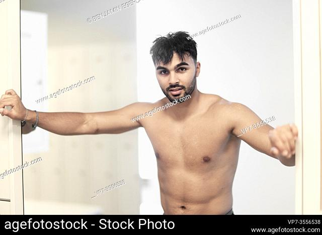 Man entering the gym shower