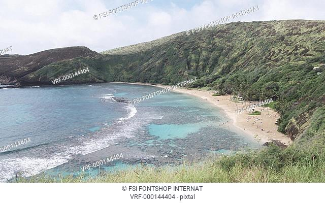 WS, Lockdown, View of a beach and cliffs behind, Honolulu, Hawaii, USA