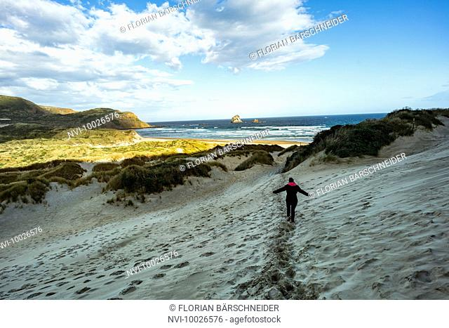 Woman on the way to Sandfly Bay, New Zealand