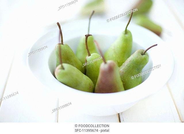 Fresh pears in a white bowl