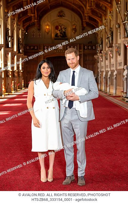 The Duke and Duchess of Sussex with their baby son, who was born on Monday morning, during a photocall in St George's Hall at Windsor Castle in Berkshire