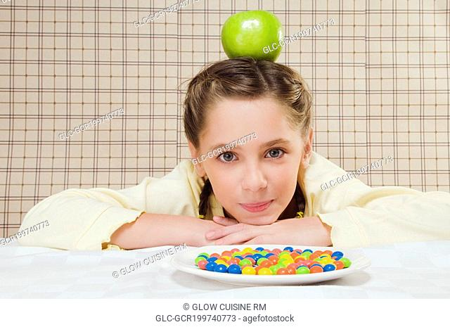 Girl balancing an apple on her head