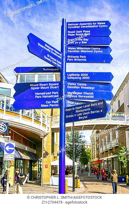 Signpost with directions written in English and welsh seen in Cardiff City Wales
