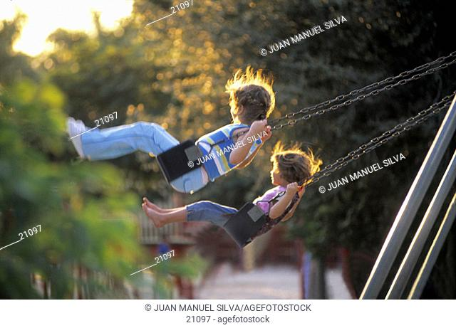 Girls on a swing in a playground