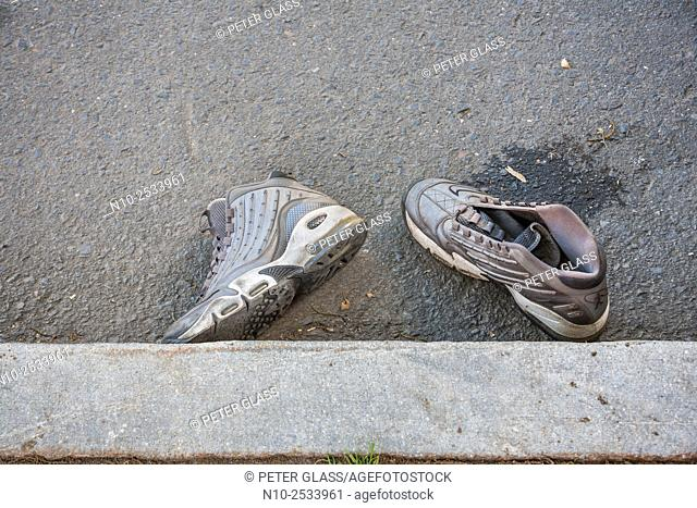 A psir of tennis shoes in the street
