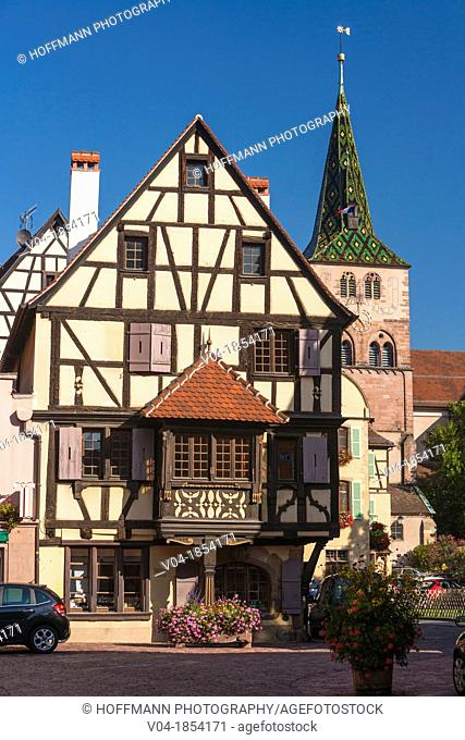 Traditional timbered house and church Sainte Anne in Turckheim, Alsace, France, Europe