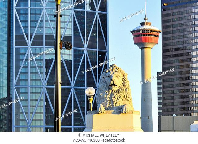 The Calgary tower and stone lion on Centre St. bridge, downtown Calgary, Alberta, Canada