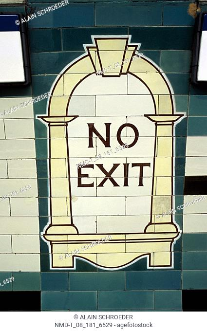 Close-up of no exit sign painted on a tiled wall, London, England