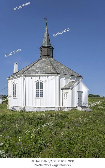 octagonal historical church on green meadows, shot under bright summer light near Dverberg, Andoya, Vesteralen, Norway