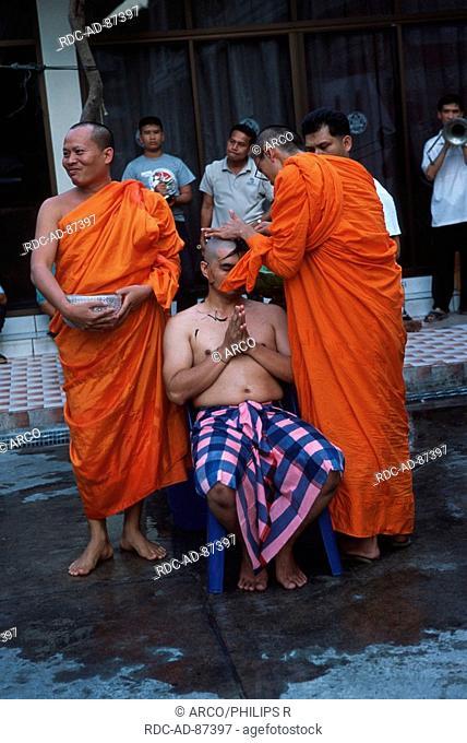 Novice monch having his hair cut, Bangkok, Thailand