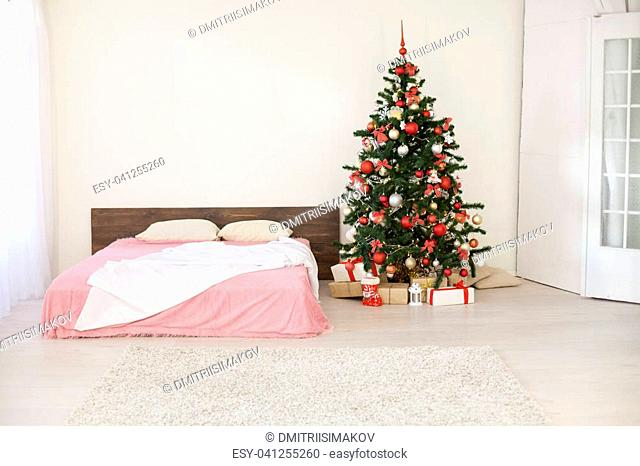 bedroom with a new year tree bed 2018 2019