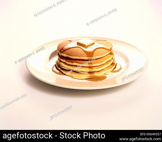 A Stack of Pancakes with Butter and Maple Syrup
