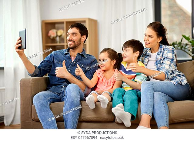 happy family having video call on tablet computer