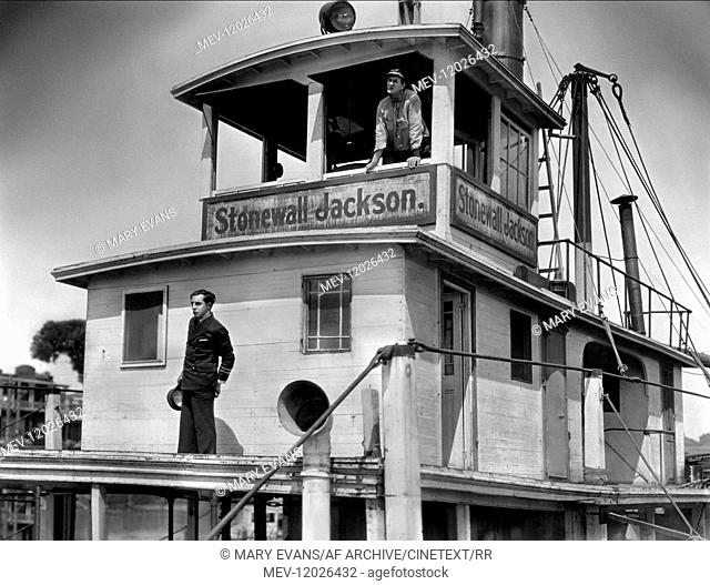 Buster Keaton & Ernest Torrence Characters: William Canfield Jr., William 'steamboat Bill' Canfield Sr. Film: Steamboat Bill, Jr