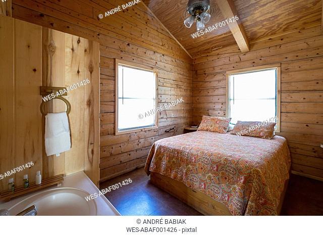 USA, Texas, Bedroom with Bathroom Vanity in log home