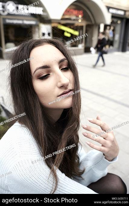 Portrait of young woman with half-closed eyes. Munich, Germany
