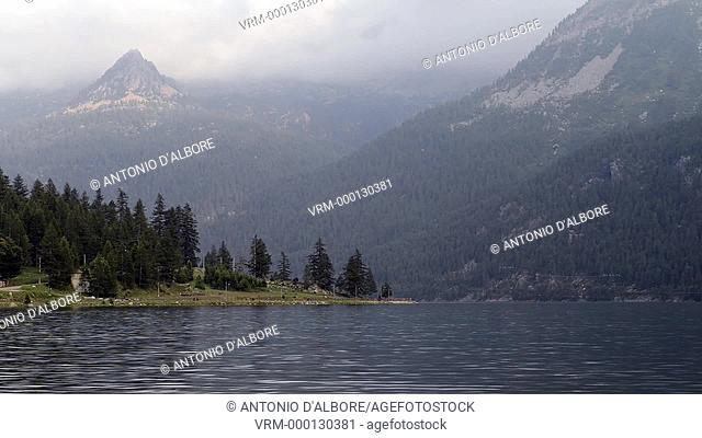 A cloudy day at a calm alpine lake