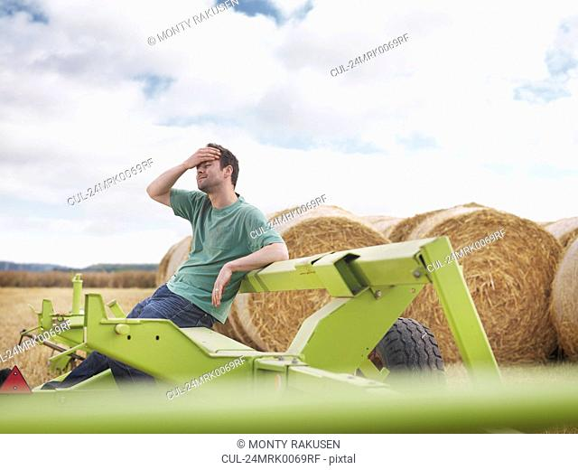 Tired farmer during harvesting