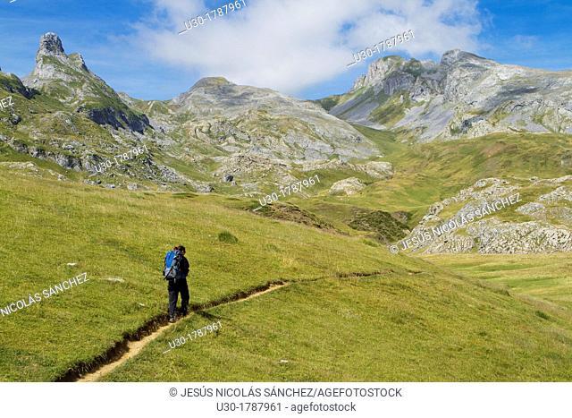 Mountaineer walking near Midi D'Ossau peak, in National Park des Pyrenees, in Bearn province  Atlantics Pyrenees  Aquitania, France  Europe