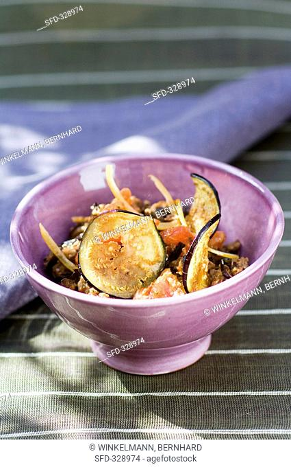 Aubergine and tomato salad in a small bowl