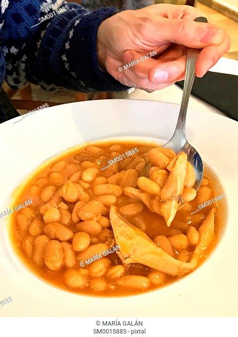 Eating beans with partridge. Spain
