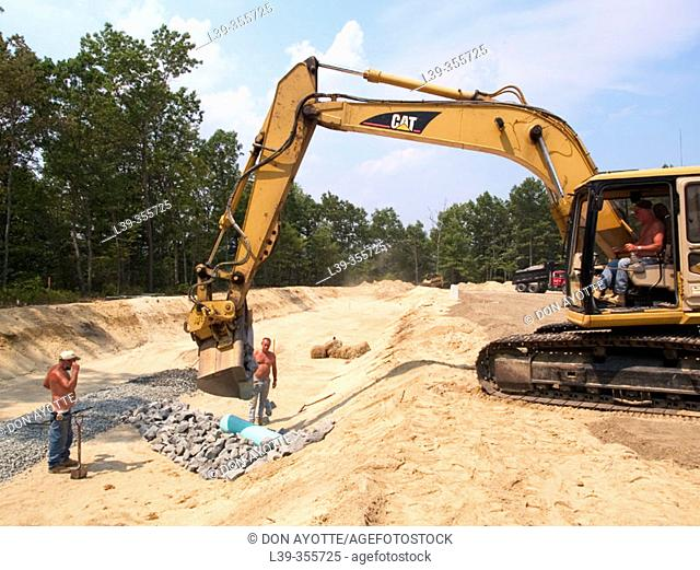 Excavator and drainage ditch workers in Massachusetts. USA