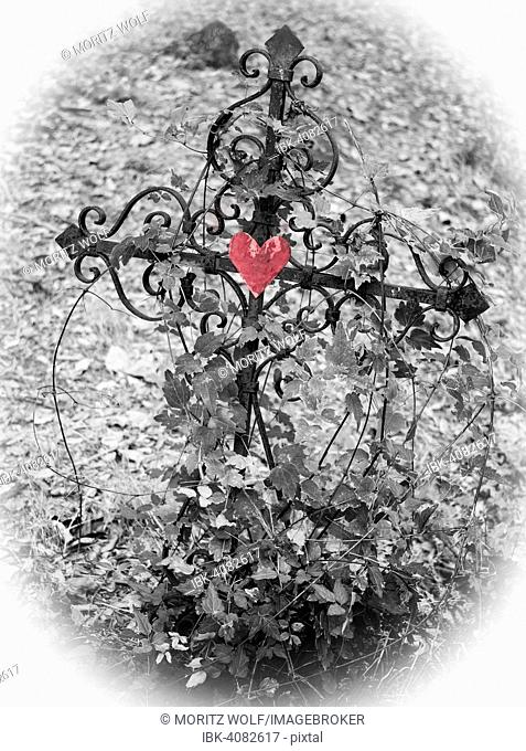Iron cross with red heart, black and white, grave in a cemetery, France