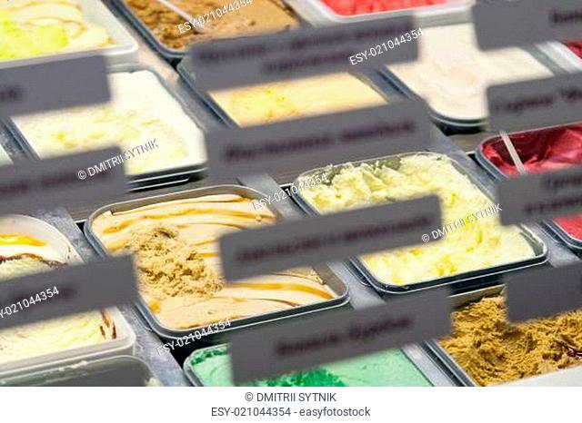 assortment ice-cream in boxes on counter with label