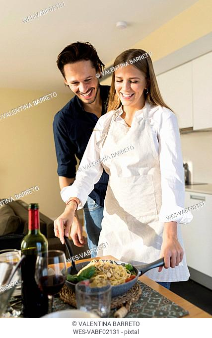 Couple preparing lunch table for friends