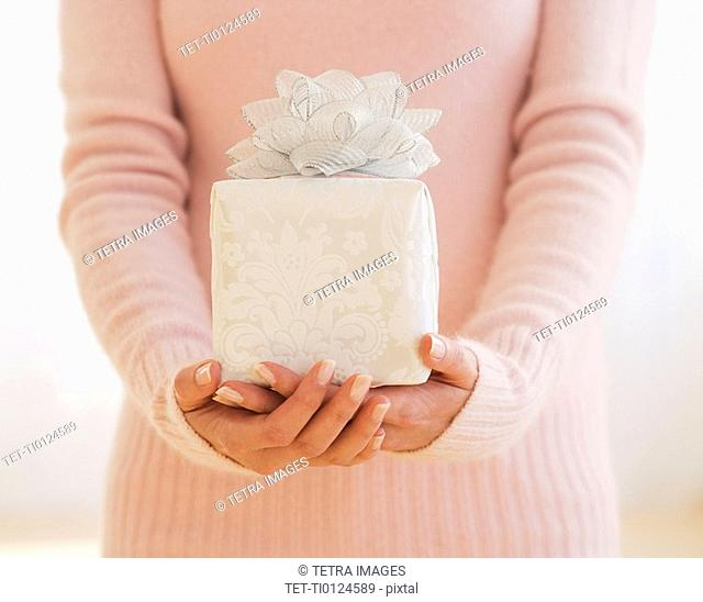 Close up of woman holding gift