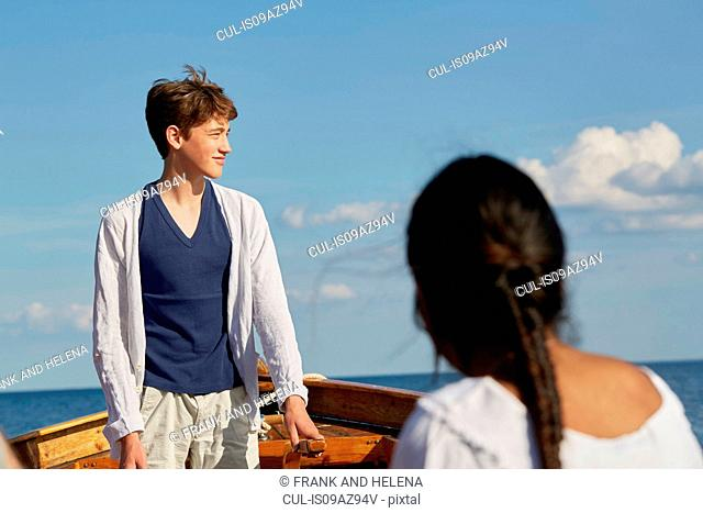 Young people on boat looking away