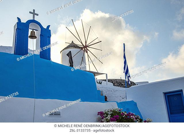 Sunrise with windmill in Oia, Santorini Greece