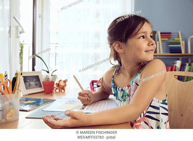 Girl doing her schoolwork at home