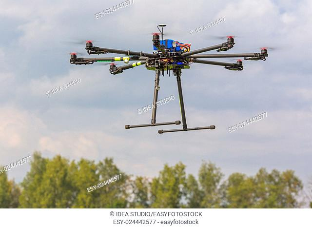 Multicopter in flight on trees background copter flying