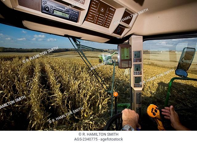 Agriculture - Interior of a combine during the corn harvest showing the yield monitor and various combine operation gauges / near Northland, Minnesota, USA