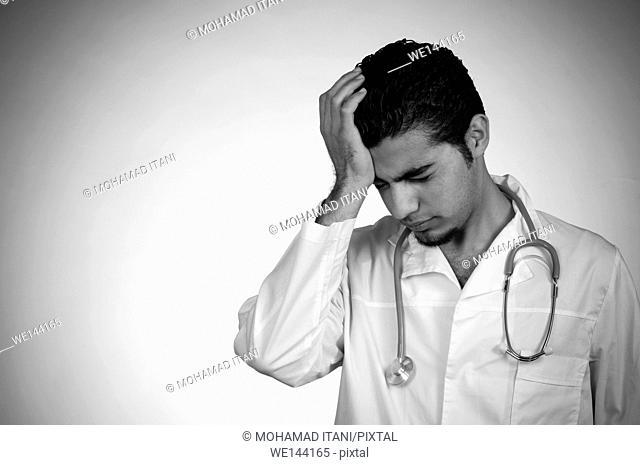 Doctor hand on head