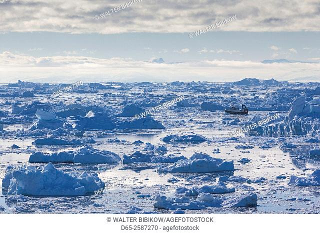 Greenland, Disko Bay, Ilulissat, elevated view of floating ice and fishing boat