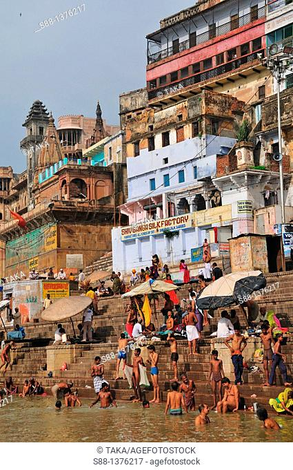 Pilgrims bathing at the ghat by the Ganges river