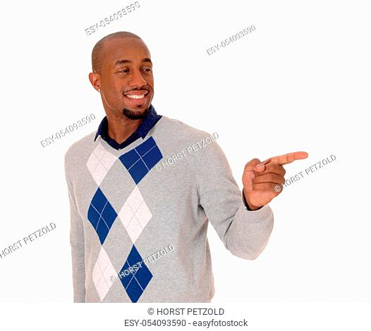 A full body image of an African American man standing in a sweater and.black pants, holding his hand out, isolated for white background