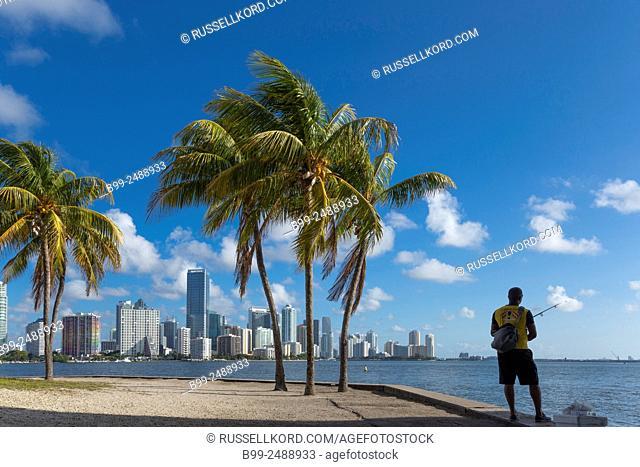 Man Alone Fishing Brickell Avenue Skyline From Rickenbacker Causeway Downtown Miami Florida Usa