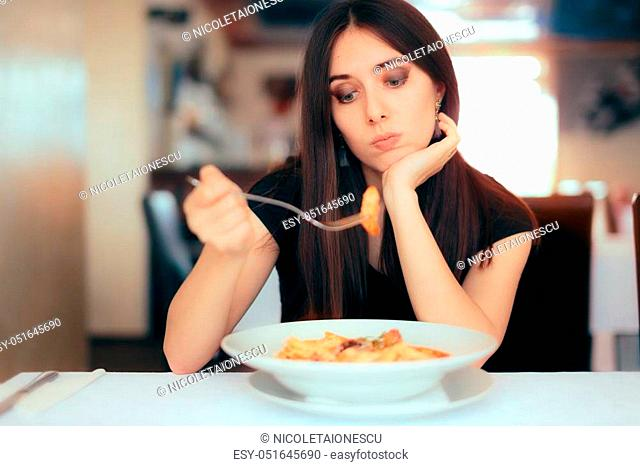 Depressed lonely woman suffering from appetite loss
