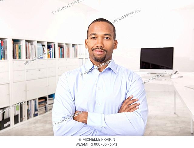 Portrait of businessman with arms crossed in the office